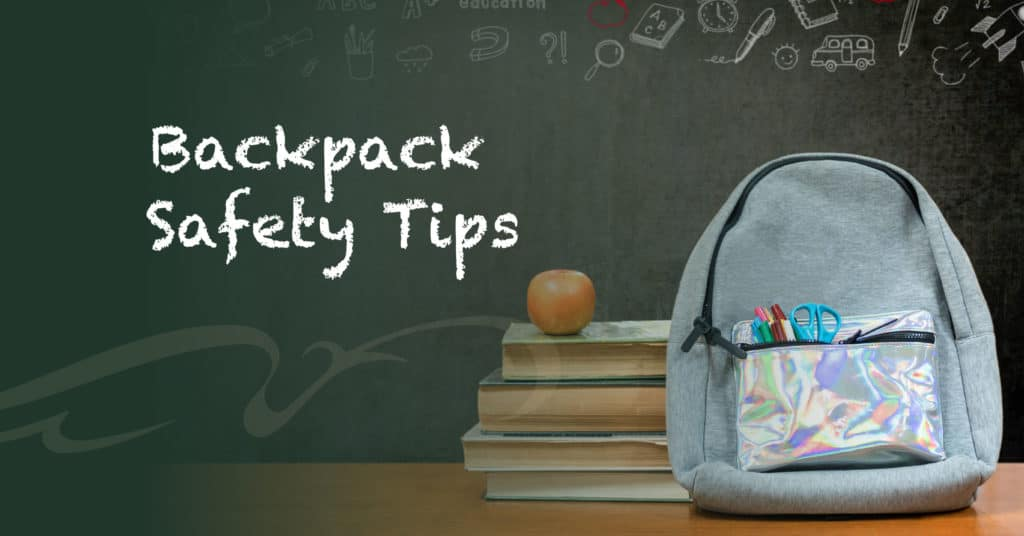Backpack Safety Tips, backpack on desk with stack of schoolbooks