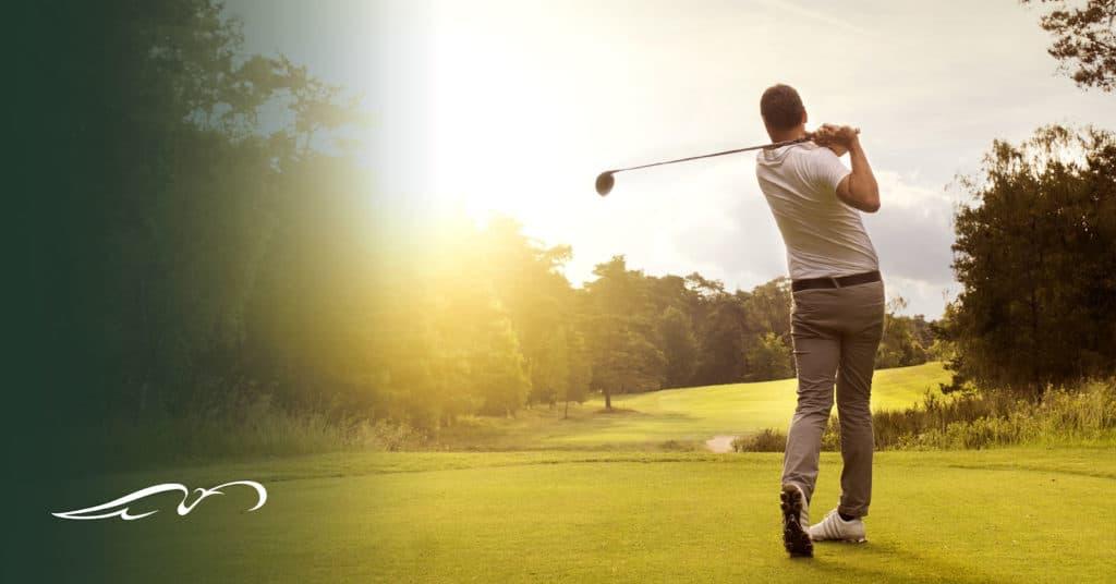 Man watching ball after golf swing