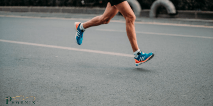 Picture of a marathon runner. Image is being used for a blog about the basics of proper foot care.