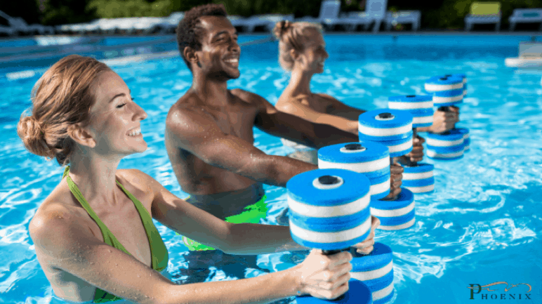 Picture of three people partaking in aquatic exercise.