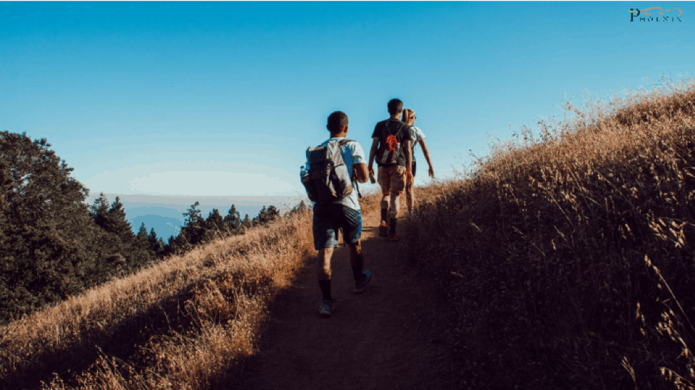 Picture of two people hiking. Image is being used for a blog post about the Benefits of walking - PHOENIX Rehabilitation and Health Services